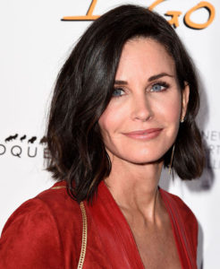 Brown tending hair with Courtney Cox and Renew